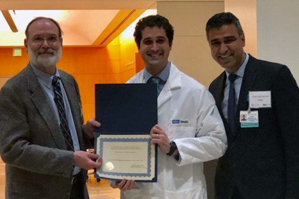 Drs. Eckenhoff and Umar present the Top Fellow award to Dr. Vikram Fielding-Singh