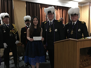 Dr. Wenlin Zhang accepts the first installment of her grant from Sir Knight Jeffrey N. Nelson and other Knights Templar at the Annual Conclave of the Grand Commandery of California. Credit: Knights Templar Eye Foundation.