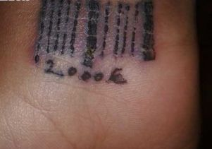 Spanish National Police<br>The wrist of a woman rescued by the Spanish National Police after being forced into prostitution. Beneath the bar code, the tattoo shows the amount of money she owed her traffickers.