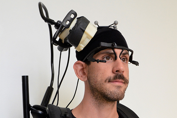 A wireless device records each patient's brain waves as he or she navigates an empty room.