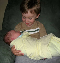 Big brother Joshua (3 yrs) and 3-day-old baby Connor